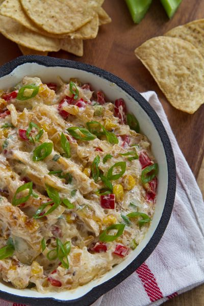 2 Tbsp. unsalted butter 2 cups corn kernels (fresh or frozen) 2 cups onions, finely chopped 2 cups red bell pepper, finely chopped 1 jalapeno, seeded and minced 3 cloves garlic, minced 1 cup mayonnaise 2 cups shredded jack cheese salt and pepper cayenne (optional)