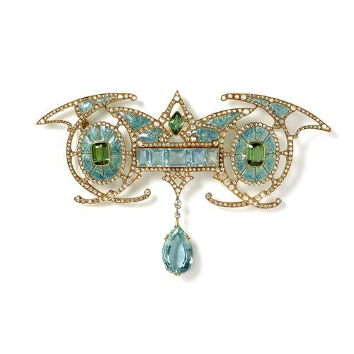 Art Nouveau brooch by Georges Fouquet, Paris, circa 1901  Magnificent Art Nouveau brooch in 18ct yellow gold symmetrically designed with a central aquamarine panel suspending a large aquamarine drop inbetween two green tourmalines within enamelled oval forms with diamond detailing Georges Fouquet, Paris circa 1901