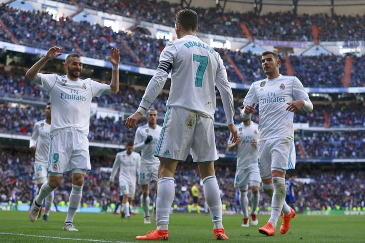 Cristiano Ronaldo Photos - Cristiano Ronaldo of Real Madrid CF celebrates scoring their opening goal during the La Liga match between Real Madrid CF and Deportivo Alaves at Estadio Santiago Bernabeu on February 24, 2018 in Madrid, Spain. - Real Madrid vs. Deportivo Alaves - La Liga