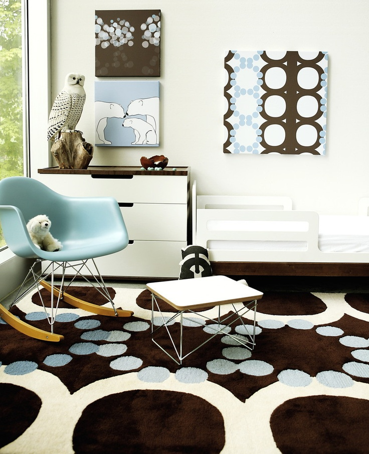 Lisa Masterson Of Avalisa Eames Turquoise Blue Rocking Chair, Blue And  Brown Circles Rug, Blue And Brown Art, Table And White Modern Chest.