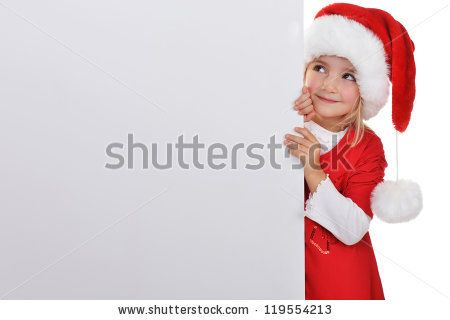 little girl in red santa hat  peeking from  billboard. - stock photo