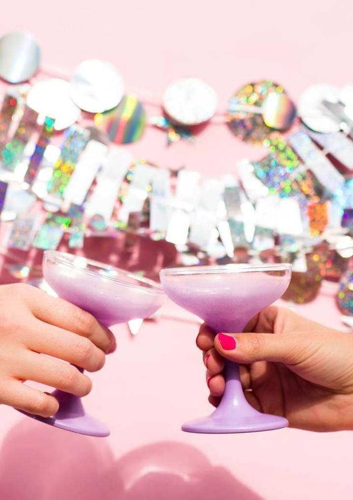 Make your New Year's Eve party shiny and sparkly with this DIY holographic garland. Punch or cut your garland into whatever shape you like, string it up and ring in the New Year in style! Click in for step-by-step instructions.