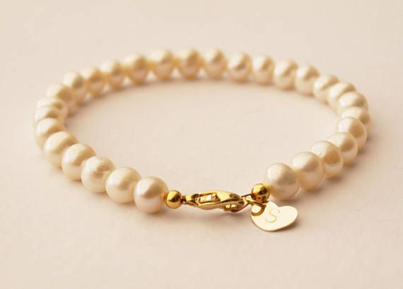 Pearl bracelet with heart initial tag
