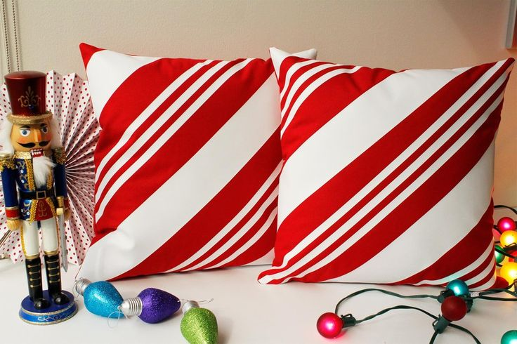 Christmas Candy Cane Throw Pillows - Celebrate Christmas with some festive holiday throw pillow covers. Make decorating fun and easy with these Christmas pillows! Save to your board for later. #roomcraft