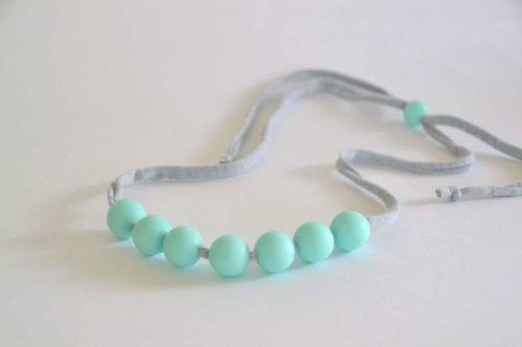 The Jersey Necklace is lightweight and adjustable with silicone beads threaded onto super soft marle grey cord. Move the beads where you like and wear as long or short as takes your fancy.Vibra...