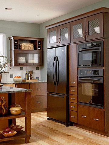 Mix of glass doors, shallow and deep drawers, and a pullout pantry next to the fridge.