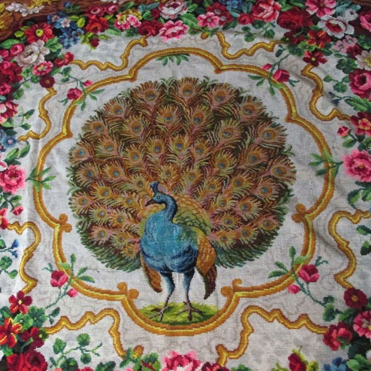 A gorgeous antique (circa late 1800s) Victorian tablecloth, tapestry or blanket.  The Tapestry is made of mohair and features a vibrant decoration of