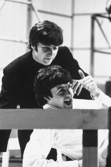 """Right off, I could see John was checking this kid out,"""" says Pete Shotton, who was standing behind John, off to the side. """"Paul came on as very attractive, very loose, very easy, very confident - wildly confident. He played the guitar well. I could see that John was very impressed.  - From The Beatles: The Biography, by Bob Spitz"""