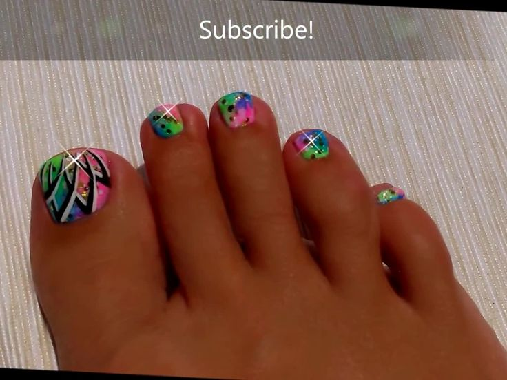 recreate this easy ombre neon toenail art design with a black and white abstract design