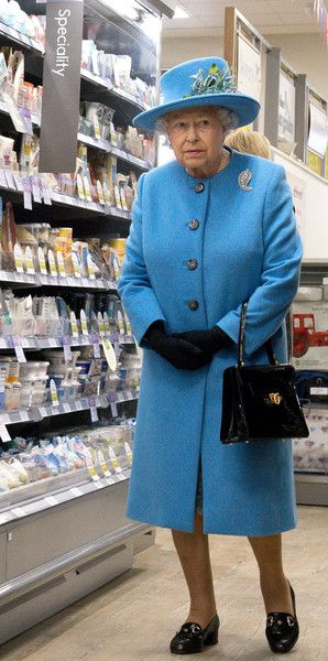 Queen Elizabeth II Photos Photos - Queen Elizabeth II looks at products on the shelves at a Waitrose supermarket during a visit to the town of Poundbury on October 27, 2016 in Poundbury, Dorset. Poundbury is an experimental new town on the outskirts of Dorchester in southwest England designed with traditional urban principles championed by The Prince of Wales and built on land owned by the Duchy of Cornwall. - The Queen, Duke Of Edinburgh, Prince Of Wales & Duchess Of Cornwall Visit…