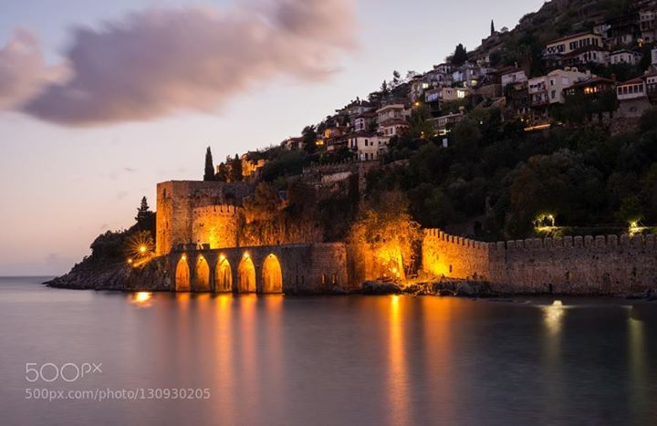 Evening view of harbour fortress and ancient shipyard in Alanya Turkey. http://ift.tt/1YI6jWc cruisealanyaancientantalyaarchitectureattractionbeachbuildingcastlecitycoastdarkdestinationfortressharborhillhistoricaljourneylandmarklightmarinamedievalmediterraneanmonumentnightpeninsularecreationredresortrivierasailingscapesceneseashipshipyardsightseeingsummersunsetswimtourismtouristtowertraveltripturkeyturkishvacationviewwater