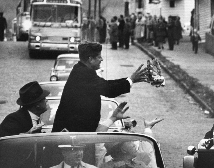 During the 1960 campaign, John F. Kennedy catches a bunch of bananas thrown to…