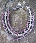 """collane """"tribalina"""", in colori perlati-metallizzati; misura media o girocollo; diametro dei dischetti cm 2,5"""