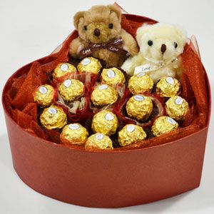 16 chocolate with 2 little bears,arranged in a heart shaped box. Bear and box color vary locally.