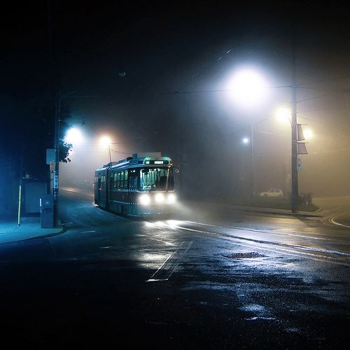 Beautiful picture of a TTC streetcar captured on a foggy night in Toronto