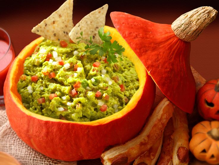 """Clean out a pumpkin and fill it with """"spookamole"""" —a delicious, fresh guacamole #recipe that's perfect for parties #halloween"""