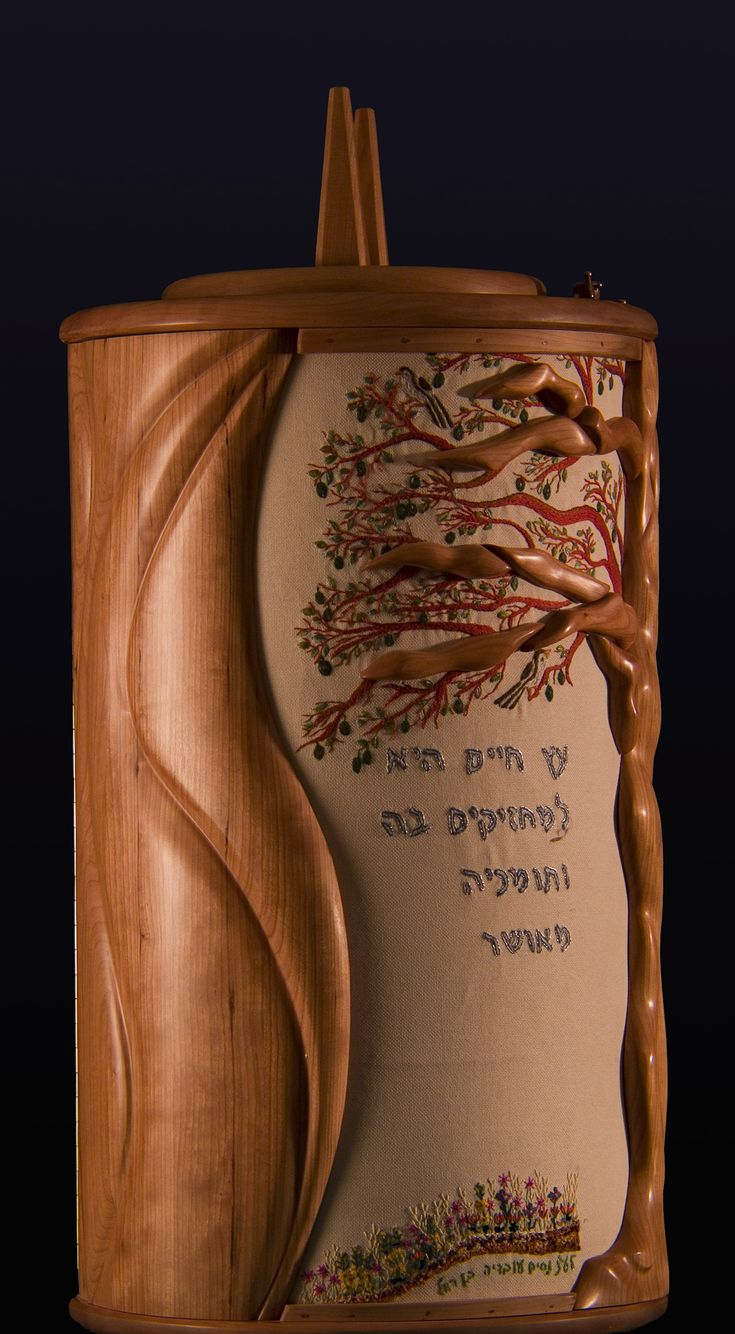 Sephardi Torah case created in memory of a fallen soldier. Torah case in cherry, custom made embroidery. In this venture Kimchi collaborated with embroidery artist Sarah Shevach. The concept incorporated is that of the tree of life.