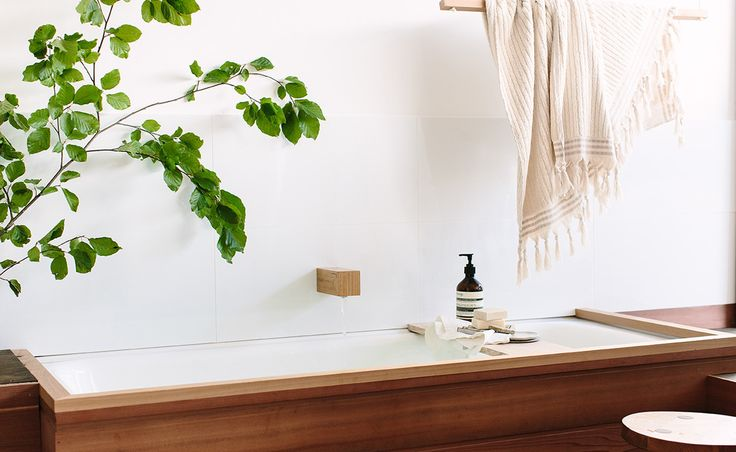 Kiri - Reclaimed timber bath spout.  LIKE Inset sink in timber. Light, airy, clean lines. Simple elegance. Timber and white. Nothing bitsy. Even the wall is simple. Flat surface instead of small tiles. WANT a bathroom that feels like a space to relax and escape