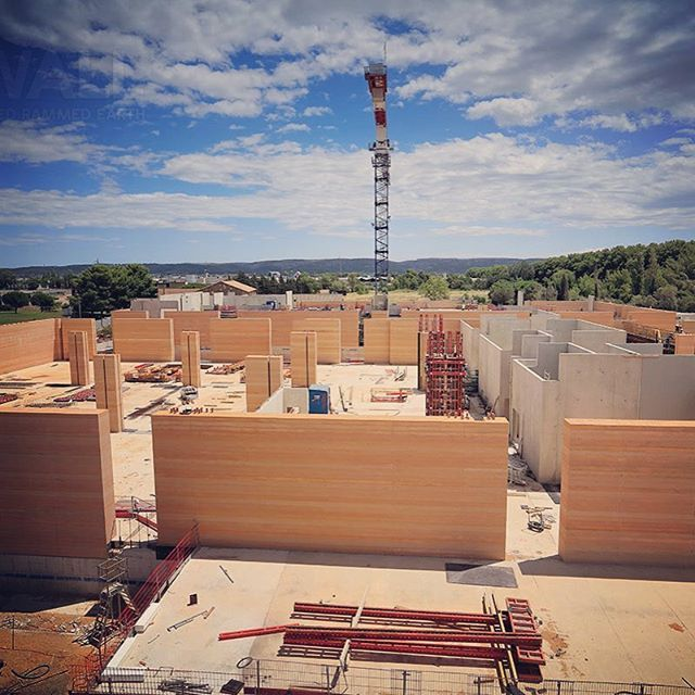 New walls on the rise in southern France. We're super excited about this huge commercial project (expected to be completed this year) but aren't going to say more just yet—enjoy!   #thermalmass #modernconstruction #sustainabledesign #sustainablearchitecture #engineeredsandstone #structuralengineering #rammedearthwall #rammedearthconstruction