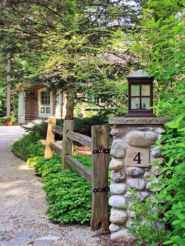 Pretty outside as well as inside                Stone pillars and split-rail fencing enhance the rustic setting.