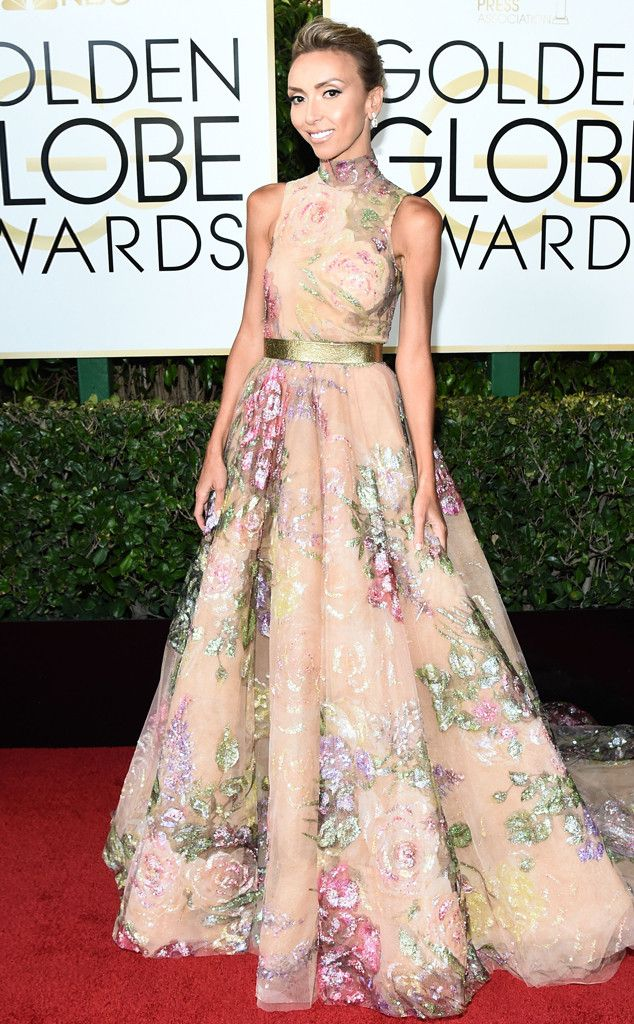 2017 Golden Globes: Giuliana Ranic is wearing a blush floral Rani Zakhem gown with a gold belt and high neckline. Glam and elegant!