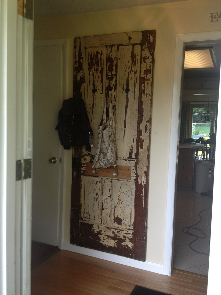 Antique door repurposed as a coat rack house ideas for Repurposed antiques ideas