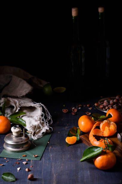 mandarin orange garden fruit nuts and wine dark romantic background