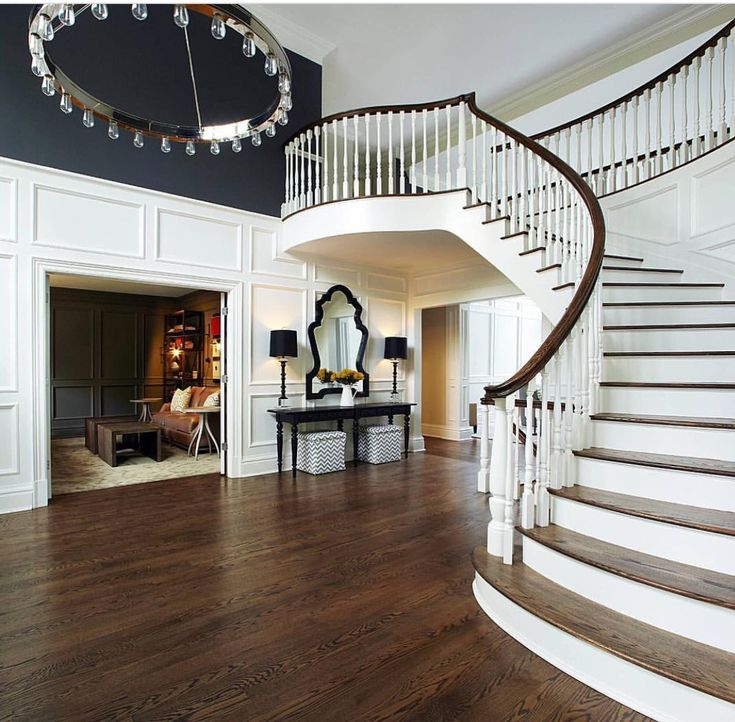 Love the trim and contrasting paint on the two story foyer wall