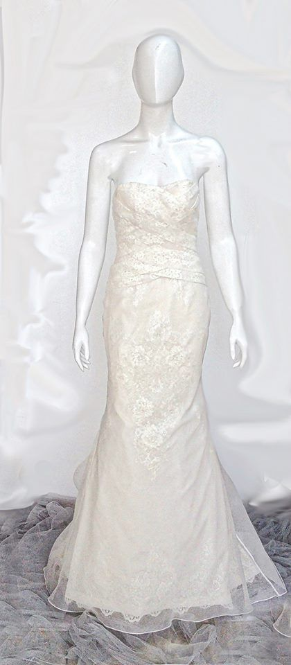 Chelsea Gown  This beautiful wedding gown features draped silk organza bodice and intricately beaded skirt.  For pricing, sizing, and ordering details please email us at nmayinda@gmail.com, Whatsapp us at 081299331039, or BB us at 2B07B968.