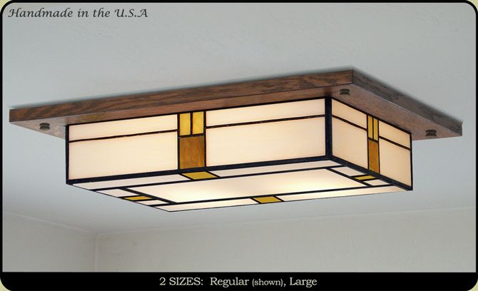 If you have low ceilings here is a great decorative mission style light.  Each light is custom made, you
