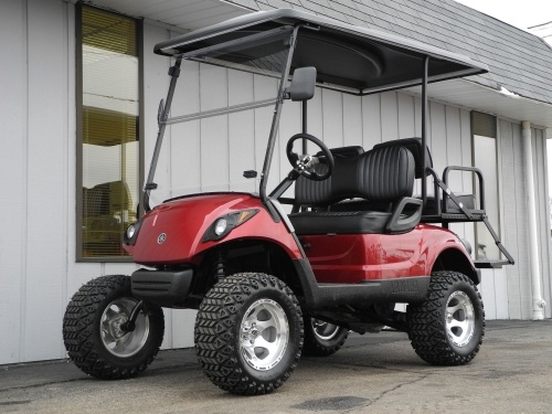 Probably the coolest cart to come out of the shop this week is this 2008 Yamaha Drive custom street-ready gas golf cart with 6-inch lift kit, 12-inch alloy wheels, premium lights, folding windshield, custom Toreador Red paint job, top-of-the-line M rear flip seat with aluminum diamond plate & folding step, extended hard top, and more.