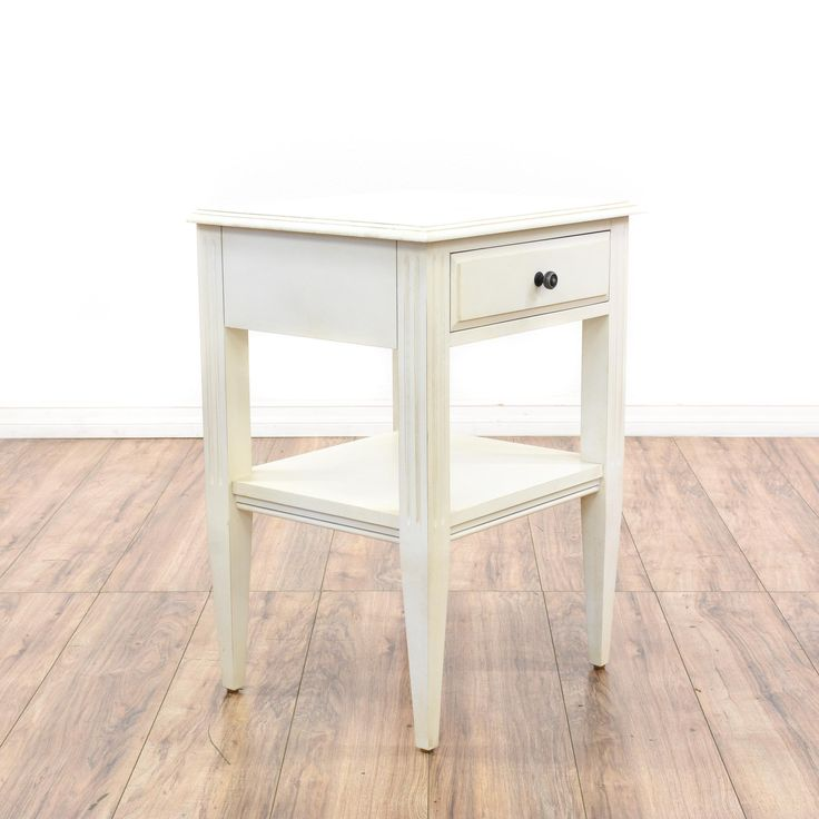 """This """"Ethan Allen"""" nightstand is featured in a solid wood with a fresh white paint finish. This contemporary end table has carved fluting, 1 drawer and a bottom shelf tier. Simple bed side table great for brightening up a bedroom! #contemporary #dressers #nightstand #sandiegovintage #vintagefurniture"""