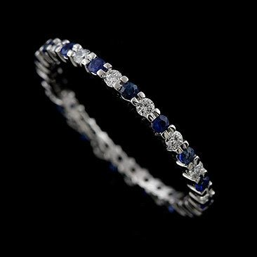 Diamond Sapphire Prong Set Eternity 14K White Gold Wedding Band. $799.00, via Etsy.
