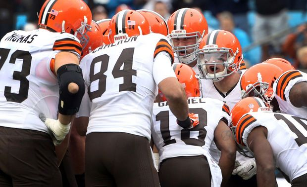 Cleveland Browns quarterback Johnny Manziel calls a play in the huddle during the first drive against the Carolina Panthers. (John Kuntz / The Plain Dealer)