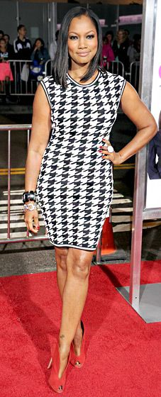Garcelle Beauvais wore a sleeveless black and white houndstooth mini-dress and red shoes for the Baggage Claim premiere.
