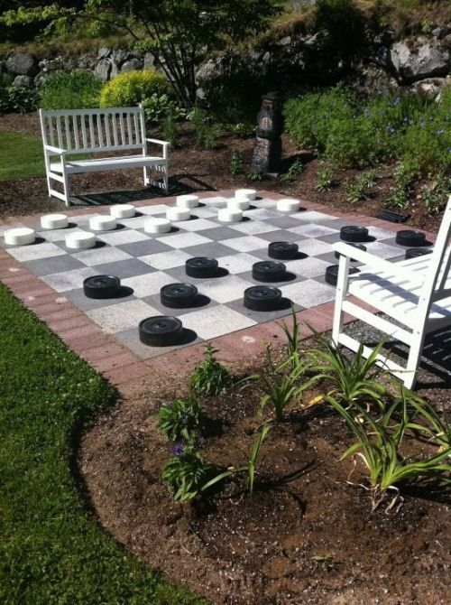 Life size checker board game with white benches.  thegardeningcook.com/best-gardens/