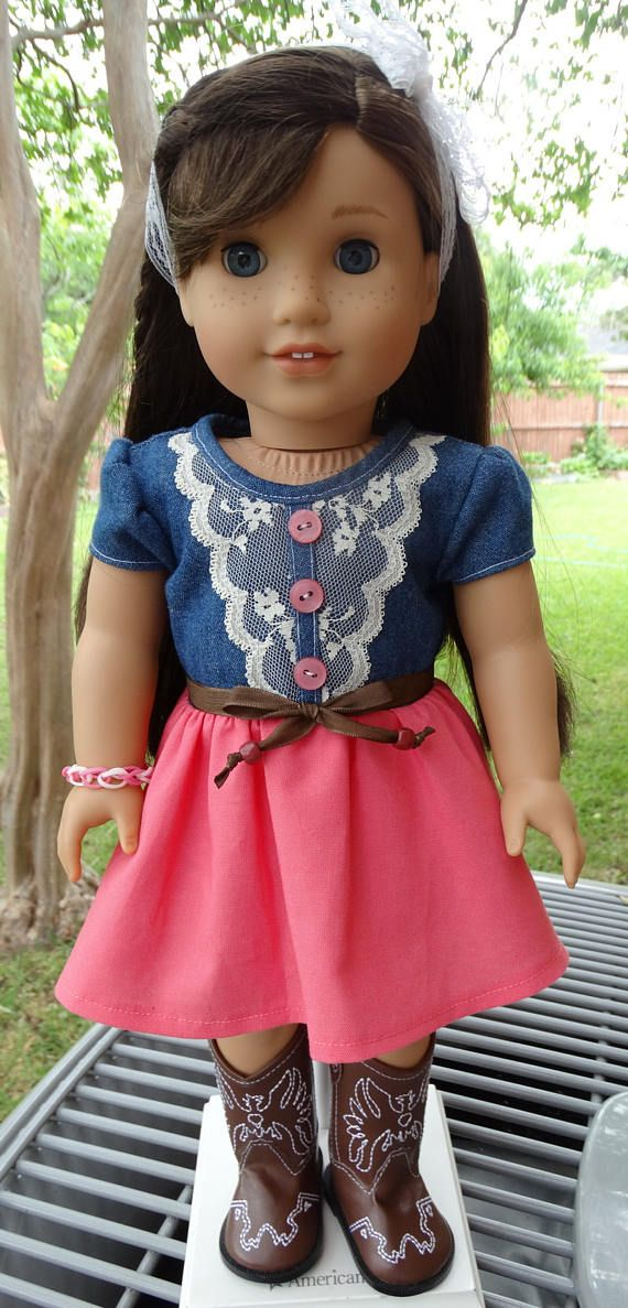 Denim and Lace Dress, Designed4Dolls on Etsy. $16.95. The denim bodice has a lace overlay and buttons in the front. The skirt is made from a coral cotton fabric. The dress closes in the back with no-snag Velcro. I added a brown ribbon belt, lace headband and rainbow loom bracelet. American Girl Grace is modeling this outfit for us. Doll and boots are not included in this sale. Price $16.95.  US buyer pays $3.75 for first...