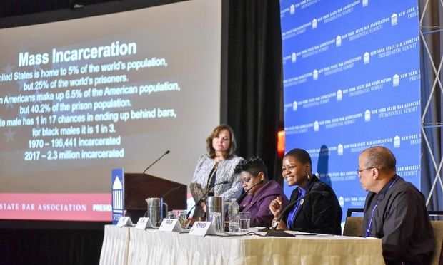 """From left, Hilarie Bass, president of the American Bar Association; Darcel Clark, Bronx district attorney; Chanta Parker of The Innocence Project; and Jeffrey Robinson of the Trone Center for Justice and Equality speak on a panel titled """"Race, Slavery and Mass Incarceration"""" at the NYSBA annual meeting on Jan. 24."""