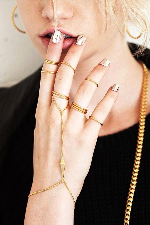 metallic nails & gold rings.
