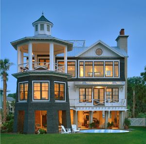home is by architect Steve Herlong of Sullivans Island,SC He took his cue from the lighthouse from the same island that was lost in a hurricane in the  1800's.This 21century home is eco friendly and and oh so chic!