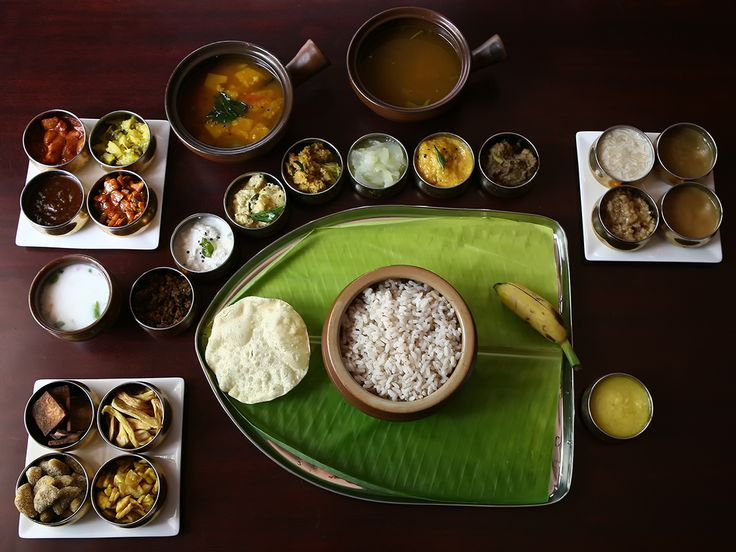 Sadhya is traditionally a vegetarian meal served on a banana leaf. People are seated cross-legged on the floor on a mat. All the dishes are served on the leaf and eaten with the hands without using any cutlery. The fingers are cupped to form a ladle. A Sadhya can have about 24-28 dishes served as a single course.