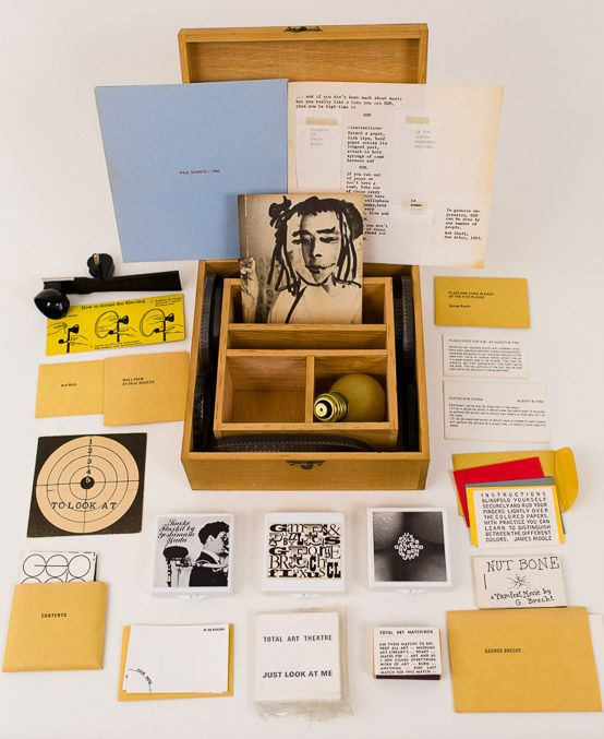 Fluxus Collective's 'Flux Year Box 2' from 1967/1968. Five-compartment wooded box contains the following works: George Maciunas-designed monogram cards for: Eric Andersen, John Cavanaugh, Fred Liberman, George Maciunas, Yoko Ono, James Vanderbeek; George Brecht; George Brecht and Ben Vautier, Willem de Ridder; Albert Fine; Paul Sharits; James Riddle; Claes Oldenburg; Yoshimasa Wada; Robert Watts; Ben Vautier ; Robert Filliou, Roland Topor, and Daniel Spoerri. 8 x 8 x 3 1/4 in.. Part of Track…