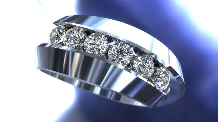 A beautiful custom white gold ring with diamonds  www.winnipegcustomjeweler.com
