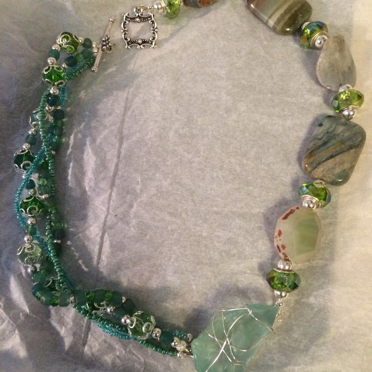 Stunning necklace with beach glass focal piece and glass beads