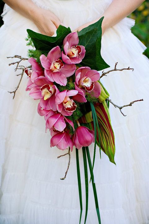 BOUQUET STYLE: tropical bouquet holder of cymbidium orchids and complimenting greenery