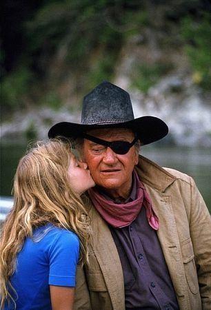 John Wayne and his daughter, Marissa, during a break from filming.