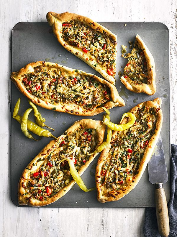 This recipe for Turkish pide with cheese and peppers is vegetarian and feeds four in under an hour. Plus, it's under 500 calories, perfect for a midweek meal.