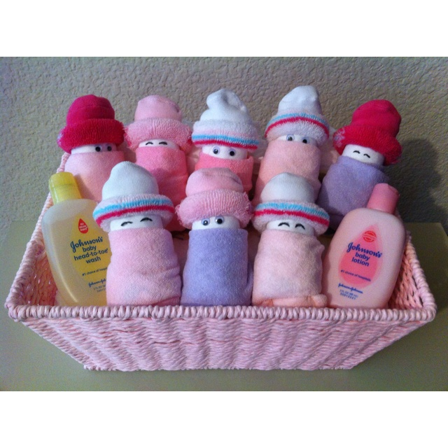 """Diaper Babies...too cute! Diapers rolled up with baby wash clothes for """"blankets"""" and socks as """"hats"""" and eyes put on their """"faces"""". Absolutely adorable!"""