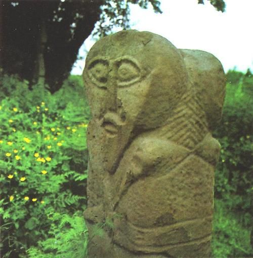 A Celtic idol with two faces (Janus form) in Caldragh graveyard on Boa Island in Lower Lough Erne, Co. Fermanagh from the early Celtic period in Ireland (probably middle of first millennium BC)
