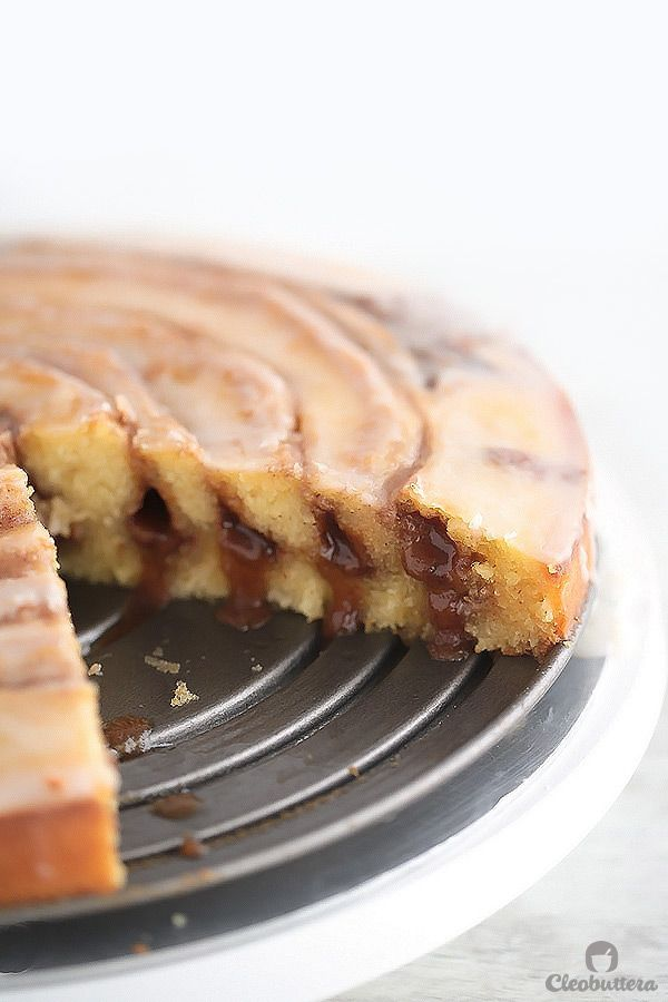 Easy Gooey Cinnamon Roll Cake--all the deliciousness of cinnamon rolls in a fraction of the time and effort. And this recipe looks absolutely DIVINE. Keep slicing that cake please:)